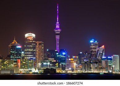AUCKLAND, NEW ZEALAND - APRIL 10: The Sky Tower glowing royal purple to celebrate the Royal tour of New Zealand on April 10, 2014 in Auckland, New Zealand.