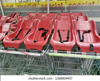 Auckland / New Zealand - April 13 2019: View of parked shopping trolleys with red child seats for young families