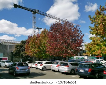 Auckland / New Zealand - April 17 2019: View of Sylvia Park extension building from car park with autumn trees