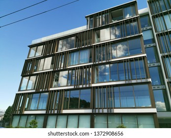 Auckland / New Zealand - April 18 2019:  View of apartment and office building 10-12 St Marks Road, Remuera with clouds reflecting in windows