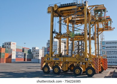 AUCKLAND, NEW ZEALAND - APRIL 19 2012: Straddle carriers and stack of containers at Auckland port. New Zealand