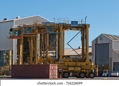 AUCKLAND, NEW ZEALAND - APRIL 2, 2012: Straddle carriers and stack of containers at Auckland sea port.
