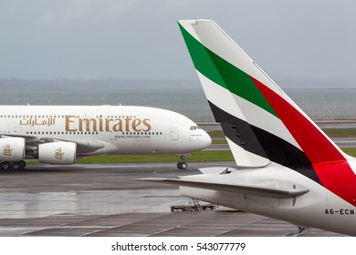 Auckland, New Zealand - April 26, 2011: Emirates Airlines Airbus A380 aircraft taxis past the tail of Emirates airlines Boeing 777 aircraft.