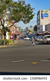 Auckland / New Zealand - April 4 2019: Lady crossing Khyber Pass Road, view from Broadway
