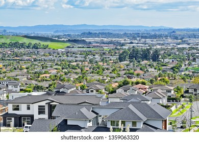 Auckland / New Zealand - April 4 2019: View of Dannemora houses and East Tamaki industrial estate in background