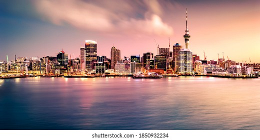 """AUCKLAND, NEW ZEALAND - Aug 18, 2018: Panoramic view of Auckland city skyline and harbour at sunset. Auckland is known as the """"City of Sails"""" and will host the America's Cup in 2021."""