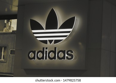 Auckland / New Zealand - August 10 2019: View of Adidas store in Britomart Downtown Auckland back-lit sign board