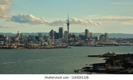Auckland, New Zealand - August 21, 2016: Cityscape, late afternoon on a clear day, with Sky Tower and port, looking over Waitemata Harbour