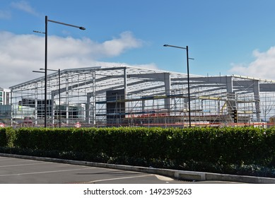 Auckland / New Zealand - August 31 2019: View of construction site of a new long span warehouse and factory building with metal frame