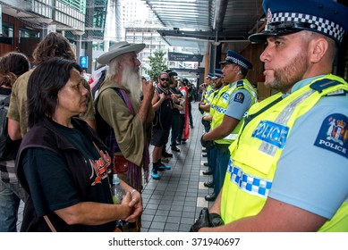 AUCKLAND, NEW ZEALAND - FEBRUARY 4, 2016 Police formed ranks around the entrance to Sky City Convention Centre, where TPPA was signed . Central Auckland was grounded to a halt for a few hours