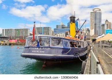 """Auckland / New Zealand - January 26 2019: A Stern View of the """"William C Daldy"""", an Old Steam Tug Built in Scotland in 1935, About to Take Tourists on a Cruise of Auckland Harbour"""