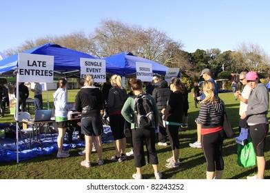 AUCKLAND, NEW ZEALAND - JULY 31: Participants of Ellerslie Half Marathon line up to register for the race in Auckland, New Zealand on July 31. 2011