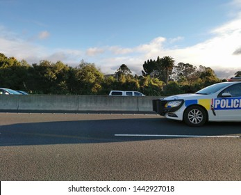 Auckland / New Zealand - July 4 2019: View of Police car with bullbar on motorway