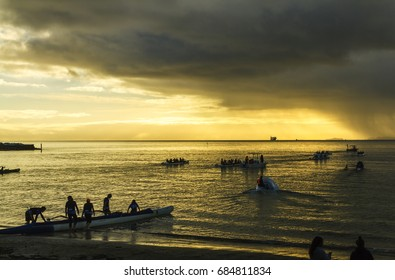 AUCKLAND, NEW ZEALAND - June 10, 2017: Editorial photo of preparation activities at Takapuna Beach during Waka Racing.