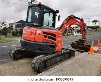 Auckland, New Zealand - March 12, 2021: View of Kubota U55 tight tail swing compact excavator on side of road