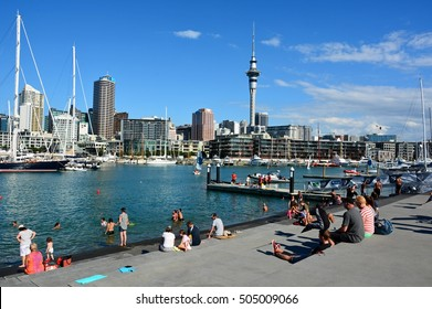 AUCKLAND, NEW ZEALAND - MARCH 14, 2015. View from the Wynyard Quarter in Auckland, with people, residential and commercial buildings, Sky Tower and boats.