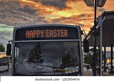 Auckland / New Zealand - March 29 2019: Happy Easter bus in sunset light