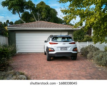 Auckland / New Zealand - March 29 2020: View of white Hyundai Kona in front of suburban garage