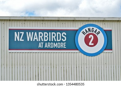 Auckland / New Zealand - March 30 2019: NZ Warbirds at Ardmore hangar and sign