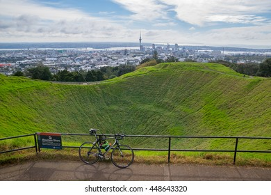 Auckland, New Zealand - May 10, 2016 : Mountain bike with Auckland skyline from Mt Eden summit. Mt Eden has a number of off-road cycle and walkways that are perfect for a recreational ride or run.