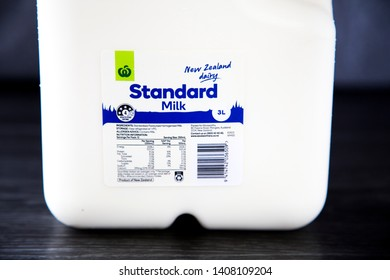 Auckland, New Zealand - May 21 2019 - large 3 litre bottle of Standard blue top New Zealand milk. Woolworths brand from Countdown. Plastic bottles are not always recycled, call for return to glass.