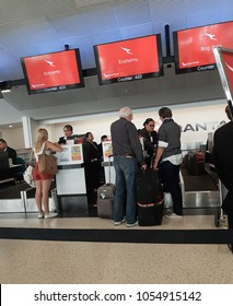 AUCKLAND, NEW ZEALAND - NOVEMBER 23: People checking in at economy counter and getting seat allocation at Qantas counter on November 23 2017 at Auckland New Zealand