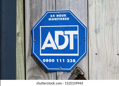 Auckland / New Zealand - October 6 2019: View of ADT Home Security 24 hour monitored sign on fence