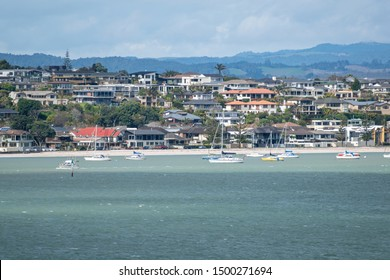 Auckland / New Zealand - September 10 2019: View of Bucklands Beach waterfront houses with Tamaki river in foreground