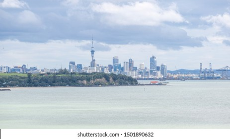 Auckland / New Zealand - September 10 2019: Distant view of Auckland city skyline from Mission Bay