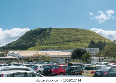 Auckland / New Zealand - September 12 2019: View of Mount Wellington with open car par in front