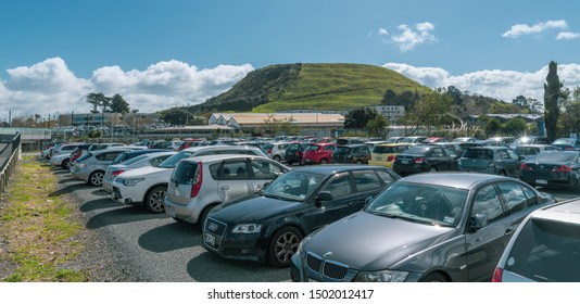 Auckland / New Zealand - September 12 2019: Wide-angle view of Mount Wellington with open car par in front