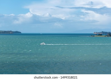 Auckland / New Zealand - September 6 2019: Remote view of 360 Discovery Cruises boat in Hauraki gulf