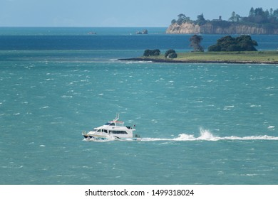 Auckland / New Zealand - September 6 2019: View of 360 Discovery Cruises boat in Hauraki gulf