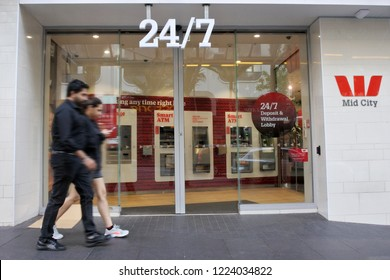 AUCKLAND - NOV 02 2018:Young couple passing by 24/7 Wespack Bank branch. Westpac Australian bank and financial-services provider have about 14 million customers, and employs almost 40,000 people