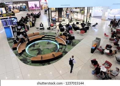AUCKLAND - NOV 20 2018:Aerial view of passengers in Auckland Airport lounge, the largest and busiest airport in New Zealand, with 19,387,627 passengers in the year ended October 2017.