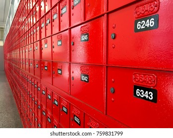 AUCKLAND - NOV 21 2017:Red PO boxes in a post office with number range and postcodes written above them. In the US two forms of identification with photo ID are required when signing up for a PO Box.