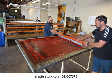 AUCKLAND - NOV 24 2015: Workers print the National New Zealand flag. Between 20 Nov and 11 Dec New Zealanders will consider options to their National Flag future.