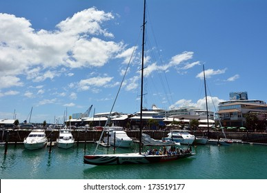 AUCKLAND, NZ - JAN 02:Visitors sail on Emirates Team New Zealand sail boat on Jan 02 2014.Team New Zealand is a sailing team based in Auckland, NZ representing the Royal New Zealand Yacht Squadron.