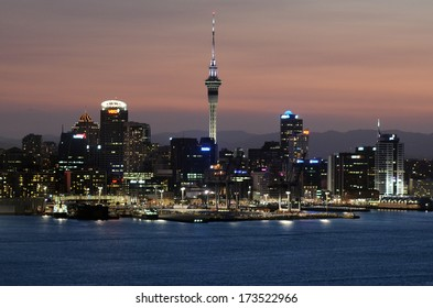 AUCKLAND, NZ - JAN 18:Auckland downtown skyline during sunset on Jan 18 2014.Auckland has been rated one of the world's top 10 cities to visit by travel bible Lonely Planet.