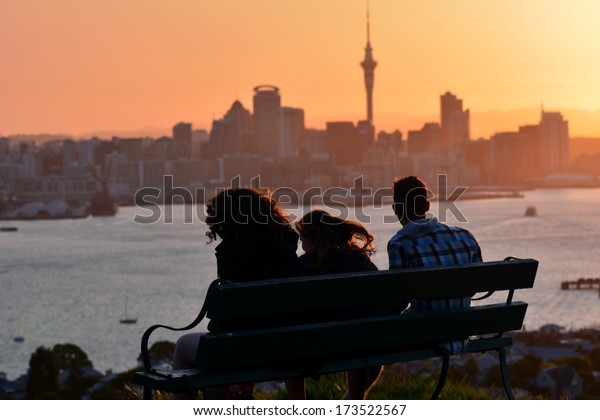 AUCKLAND, NZ - JAN 18:People looks at Auckland downtown during sunset on Jan 18 2014. Auckland has been rated one of the world's top 10 cities to visit by travel bible Lonely Planet.