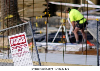 AUCKLAND, NZ -JULY 29: Construction site safety sign and worker without hard hat on July 29 2013.Construction is one of the most dangerous land-based work sector in the world.