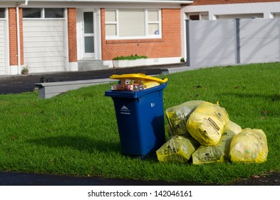 AUCKLAND, NZ - MAY 27:Rubbish and recycling the street on May 27 2013. New Zealand generates 400kg of rubbish per capita. This is higher than the in other OECD member countries with average of 372kg.