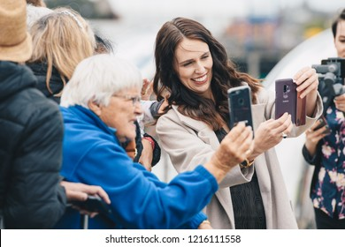 AUCKLAND, NZ - OCTOBER 30: New Zealand Prime Minister Jacinda Ardern takes photos with fans in Auckland during the Duke and Duchess Royal Tour on October, 2018 in Auckland, New Zealand.