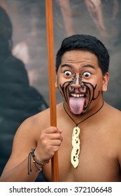 AUCKLAND,  NZL - JAN 30 2016:Maori man in traditional greeting.Maori are the indigenous people of New Zealand that migrated to New Zealand from Polynesia1000 years ago.