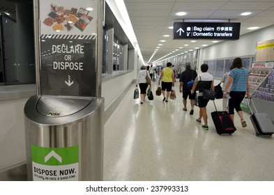 AUCKLAND, NZL - NOV 22 2014:Biosecurity bin in Auckland AIrport.New Zealand has very strict biosecurity procedures at airports and ports to prevent the introduction of pests and diseases.