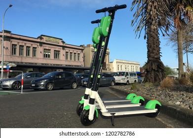 AUCKLAND - OCT 15 2018:Lime electric scooters in Auckland, New Zealand.The scooters have a 48km maximum range. Users find, unlock and pay for them using an app and leave them at their destination.