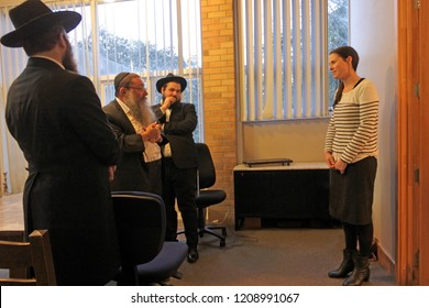 AUCKLAND - OCT 17 2108:Woman converting to Judaism standing in front of a Jewish court of law. About 500 converts to Judaism each year, mainly formerly Christian women who married Jewish men.