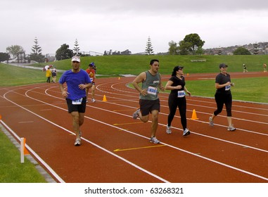 AUCKLAND- Oct. 17: Participants in the Sir Barry Curtis 10K Classic run sprint to the finish line on sunday Oct. 17,2010 at Pakuranga, Auckland, New Zealand