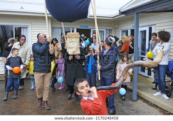 AUCKLAND - SEP 02 2018: Torah scrolls are escorted to a new synagogue during Inauguration of a new Torah scroll ceremony.It is a handwritten copy of the Torah, the holiest book in Judaism.