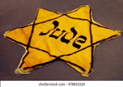 AUCKLAND - SEP 04 2016:Yellow Jewish badge. It is a cloth patch that Jewish people were ordered to sew on their outer garments to mark themselves in public in certain times during their history.